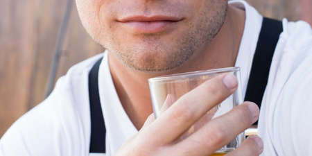 gusto: Man holding alcohol outdoors Stock Photo