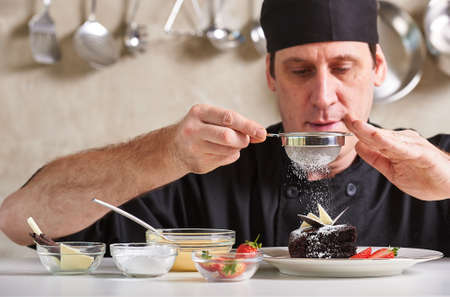 Restaurant hotel private chef preparing desert chocolate cake Фото со стока