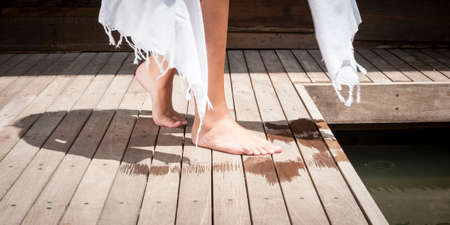 skin diving: close up of young attractive womans legs and feet next to pool