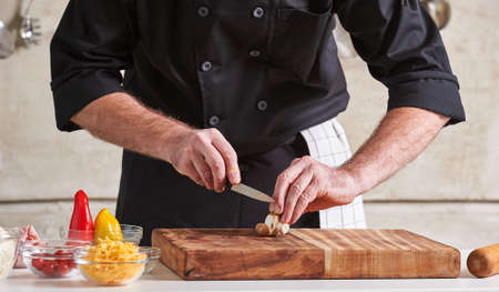restuarant: Restuarant hotel private chef cutting mushrooms on board
