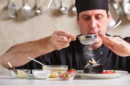 Restaurant hotel private chef preparing desert chocolate cake Standard-Bild