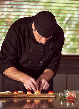 Restaurant hotel private chef preparing canapés in kitchen