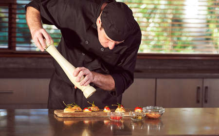 Restaurant hotel private chef preparing food in kitchen Zdjęcie Seryjne