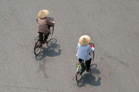 conical hat: Cycling in Conical Hats