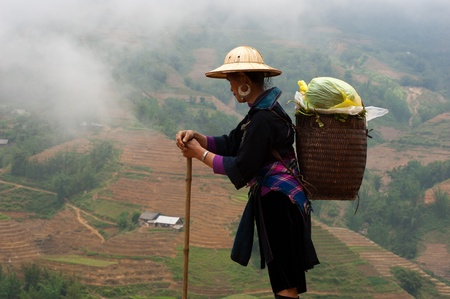 lao: Black HMong in a misty Sapa Editorial