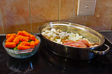 Raw ingredients in two dishes for making chicken casserole Stock Photo