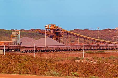 Iron ore stockpile and ore train