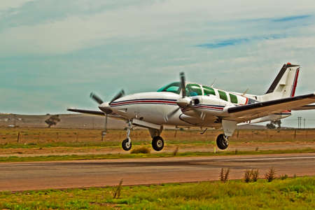 White twin engine aircraft shortly after take off
