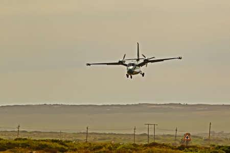 Twin-engine pusher propeller aircraft landing Stock Photo