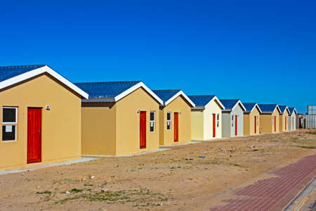 Row of newly built low-cost RDP homes in Western Cape, South Africa Stock Photo