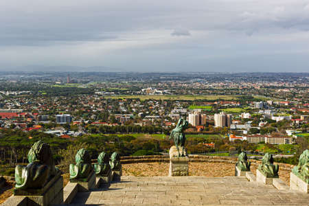 View over Cape Town suburbs with statues and steps of Rhodes Memorial in foreground Stock Photo