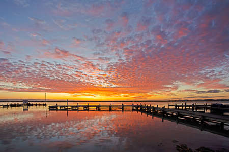 Sunset over jetty and Berg River in Western Cape, South Africa