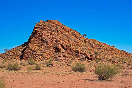 Rugged rocky hill with reddish rocks in arid Northern Cape, South Africa