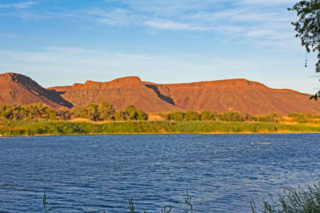 Landscape of wide Orange River and Namibian mountains near Vioolsdrif in Northern Cape, South Africa