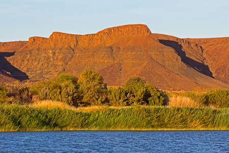 Imposing mountains in Namibia behind Orange River in Northern Cape, South Africa