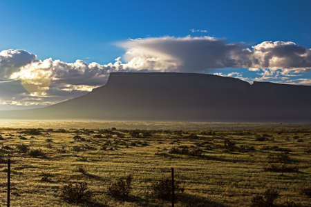 Landscape of Windhoek berg silhouetted in early morning sun in Western Cape, South Africa Banco de Imagens