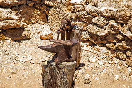 Ancient anvil and vice in outdoor workshop in Kalahari Region of South Africa