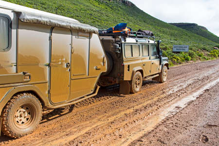 4X4 Vehicle and caravan on muddy Botterkloof Pass in Northern Cape, south Africa