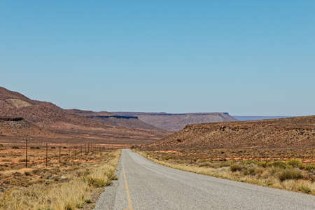 Straight road through flat topped hills in Karoo