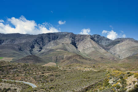 Imposing Langeberg Mountains in Little Karoo with blue sky and white clouds in Western Cape, South Africa Zdjęcie Seryjne