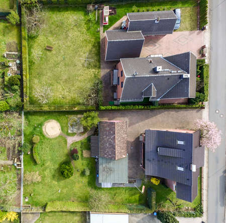 Aerial photo with the drone, a new build-up plot with single houses and gardens, narrow neighborhood Stockfoto