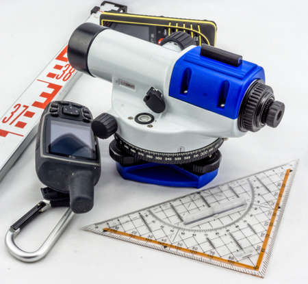 Levelling device, staff, yardstick, ruler, GPS, rangefinder in front of white background Фото со стока - 90541173