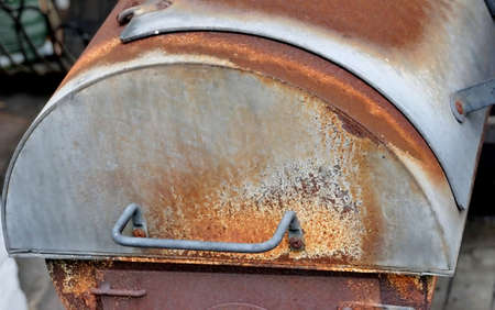 Age smoker, close-up of the rusty firebox of the grill device