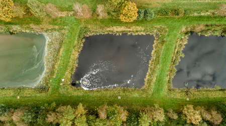 fish breeding basin with ventilation, aerial view with drone Stock Photo