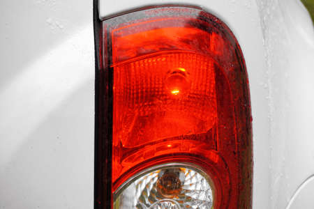 Red taillight of a car, close-up, detail
