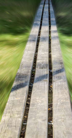 Empty wooden bench, alienated by motion blur