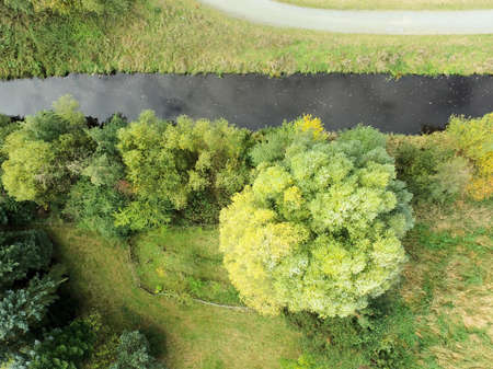 Path, stream and meadow from the air with the drone photographed, abstract and background Stock Photo