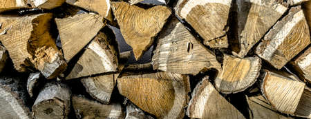 Close-up view of a stack of chopped wood for the fireplace fire in winter, background or wallpaper Stock Photo