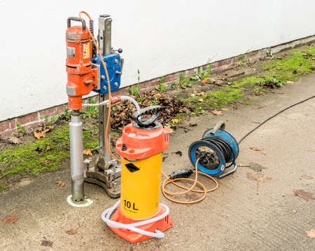 Core drilling machine for use on a concrete surface