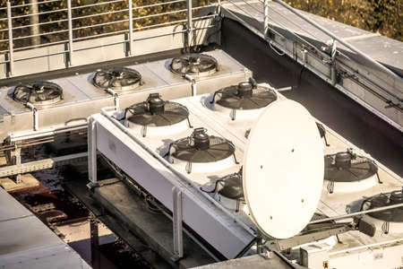Fans for the air conditioning system of the Faculty of Mathematics at the University of Leipzig, satellite dish