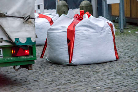 Gifhorn, Lower Saxony, Germany, December 2,2017: Edge of the Christmas Market with Barriers camouflaged as gifts to protect against terrorist attacks with trucks