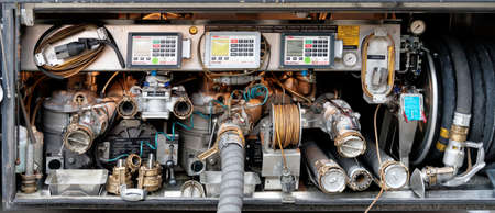 Wolfenbuettel, Lower Saxony, Germany, January 12,2018: Fittings, connections, pressure gauges and measuring instruments on a tanker for fuel and heating oil on delivery.