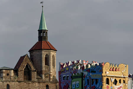Brunswick, Lower Saxony, Germany, January 27,2018: The old Magnikirche behind the modern house of the artist Rizzi