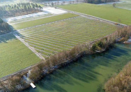 Aerial photographs, new drainage strands for draining arable land in spring, drone shot