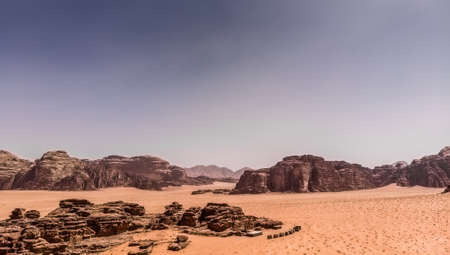 Aerial view of the gigantic rocks and mountains in the nature reserve of Wadi Rum, made with drone