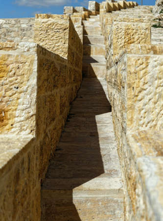 Narrow stairway on the outer wall of the large Crusader fortress in Karak, Jordan, middle east Stock Photo