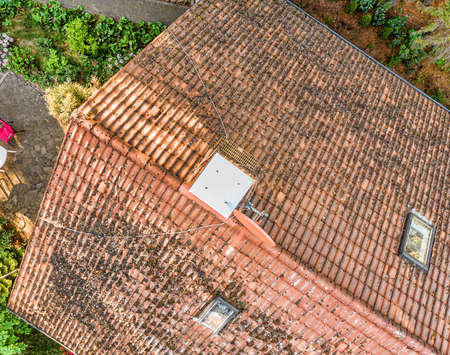 Overflight of the roof of a single-family house to check the condition of the roof tiles, aerial view made with drone Stock Photo