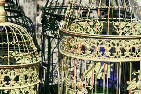 Antique bird cages decorated with ornaments at a flea market, Germany