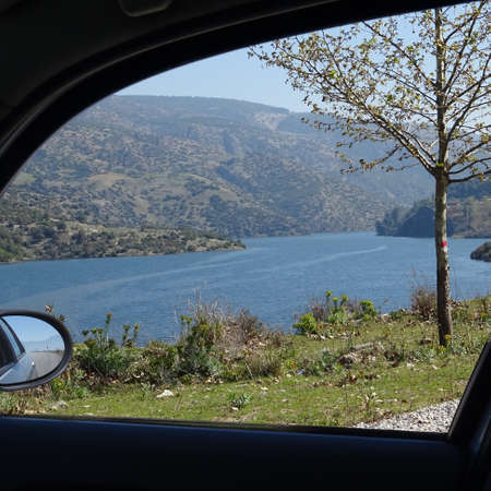 View through the side window of a rental car to a reservoir in the heart of Anatolia, Turkey