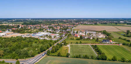 Aerial view of an industrial estate on the outskirts of Wolfsburg, Germany, with a football pitch in the foreground, made with drone