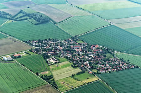 Aerial view from a small airplane 900 meters above sea level from a village suburb of Salzgitter, Germany, lower saxony