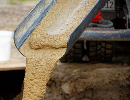 Liquid soil is poured from the ramp of concrete mixer, Germany