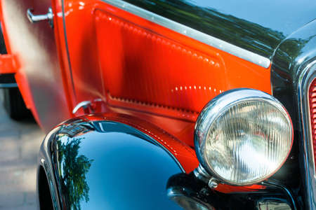 Detailed view of a historic vehicle with free headlights, red bonnet and black shiny wings, Oldtimer-Festival, Germany
