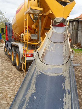 Direct view of the empty and clean ramp of a concrete mixer on a construction site, Germany Foto de archivo - 103458853
