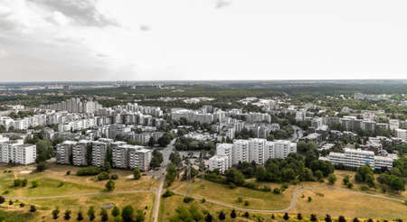 Aerial view of a high-rise housing estate on the edge of a large industrial city with ugly old dirty high-rise buildings with cheap rental apartments in northern Germany