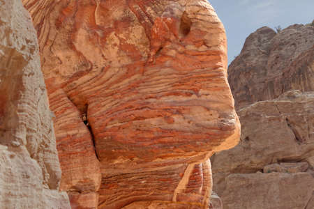Sandstone coloured red, orange and black by iron and manganese compounds of Petra, Jordan